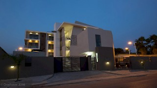 Devtraco Plus Ghana Limited Avant Garde night view with front gate