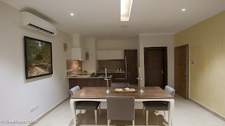Devtraco Plus Ghana Limited Avant Garde two bedroom apartment - dining area and kitchen